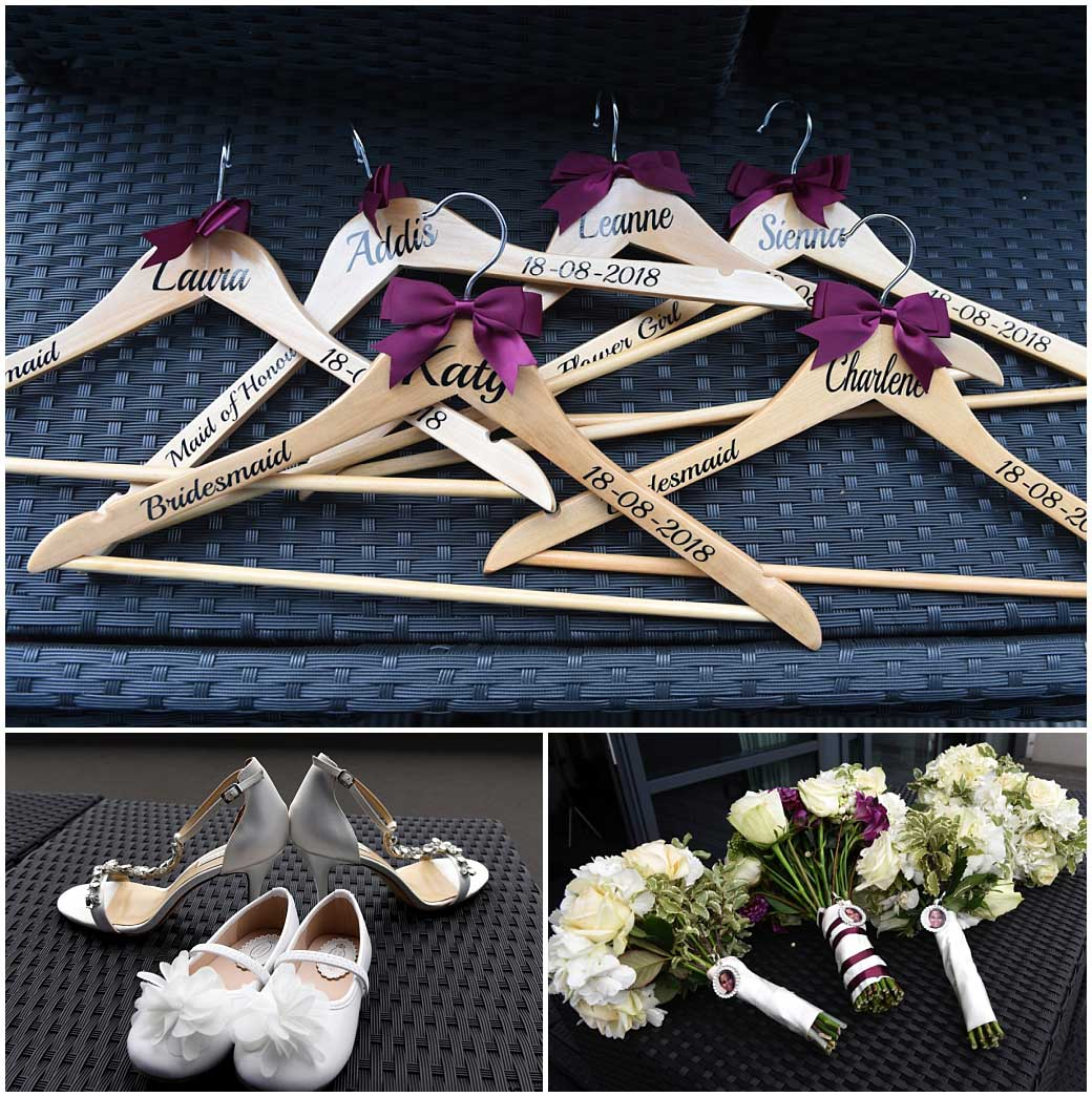 Wedding shoes, bouquets and personalised clothes hangers on display before leaving The Brooklands Hotel for the nearby Surrey event venue Painshill Park in Cobham