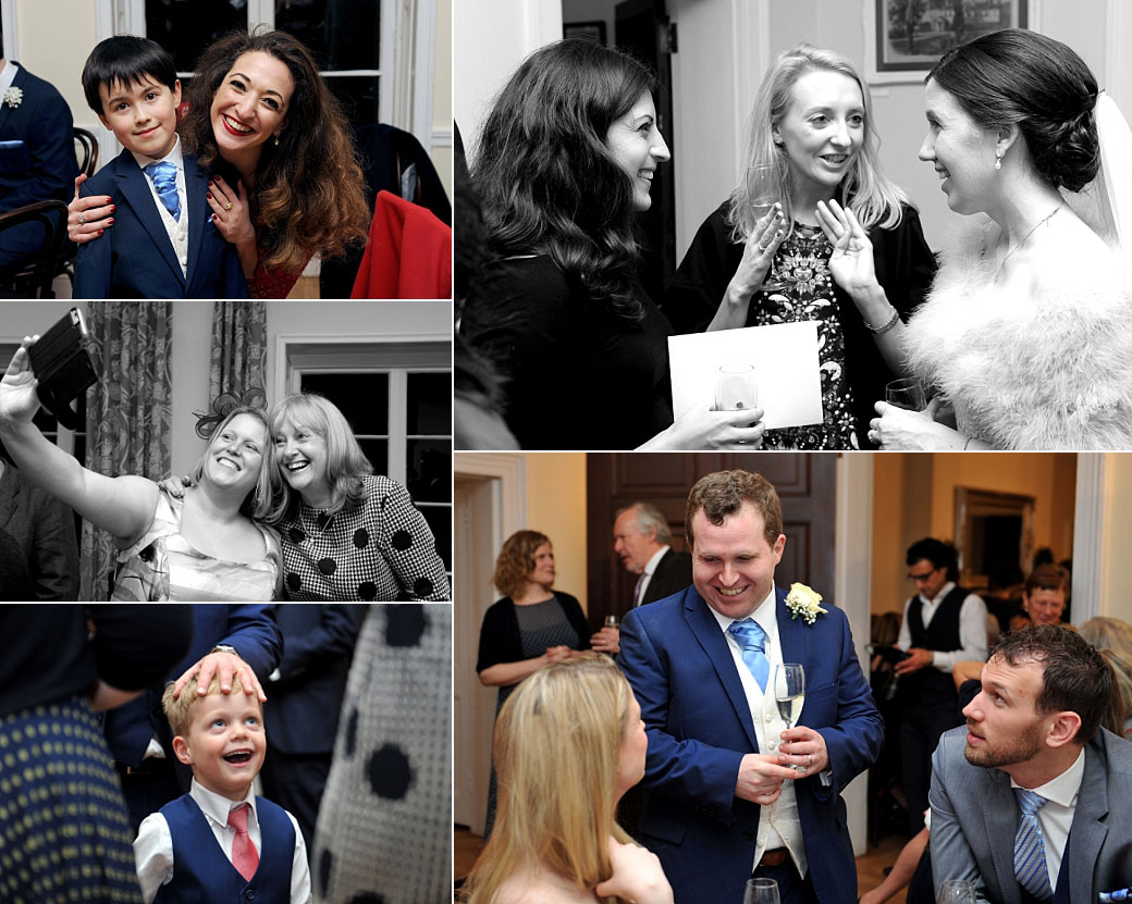 Bride and groom captured at Surrey venue Pembroke Lodge enjoying mingling with their guests during their wedding  drinks reception in The Soane Room