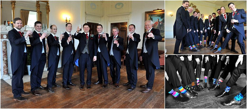 Groom and gents at Surrey wedding venue Addington Palace raise their glasses of beer and show off their brightly coloured socks in these fun and relaxed wedding photos