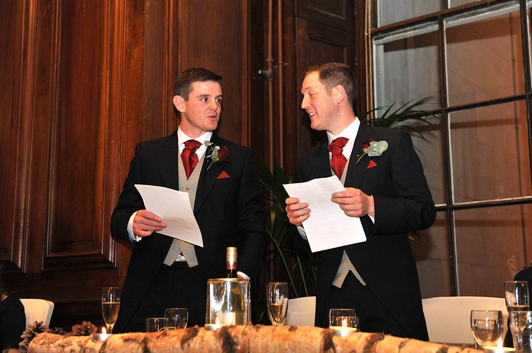 Entertaining groomsmen in the Great Hall at Surrey wedding venue Addington Palace throw out some witty banter during their thoroughly enjoyable wedding speech