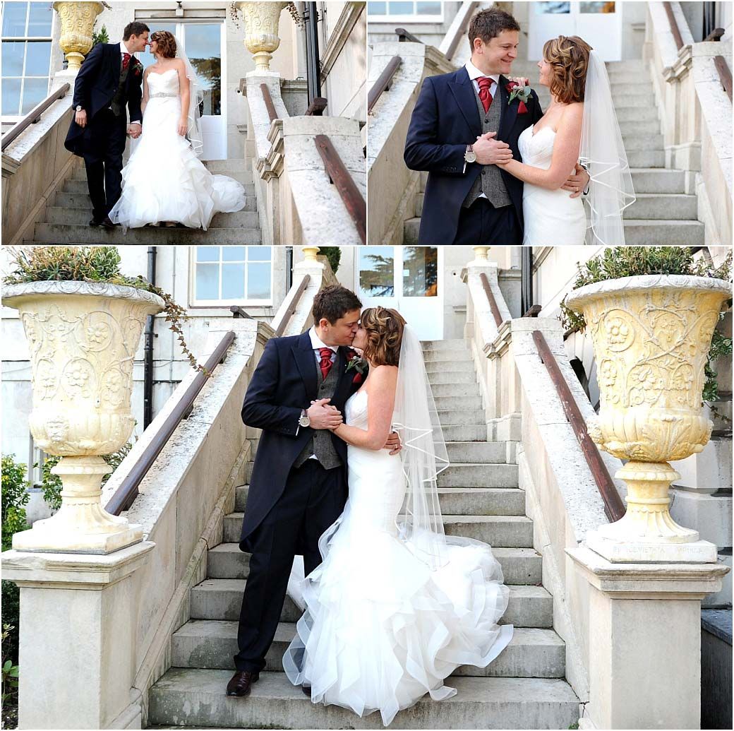 Romance on the steps of the magnificent and stately Addington Palace in Croydon Surrey in these wedding photos of a handsome Bride and Groom kissing and holding hands