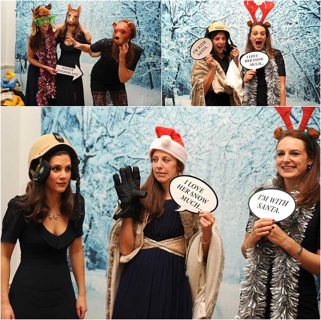 Animal faces, Santa hands and  speech quotes for these girls enjoying the open plan photo booth set up at Addington Palace a Surrey wedding venue in Croydon