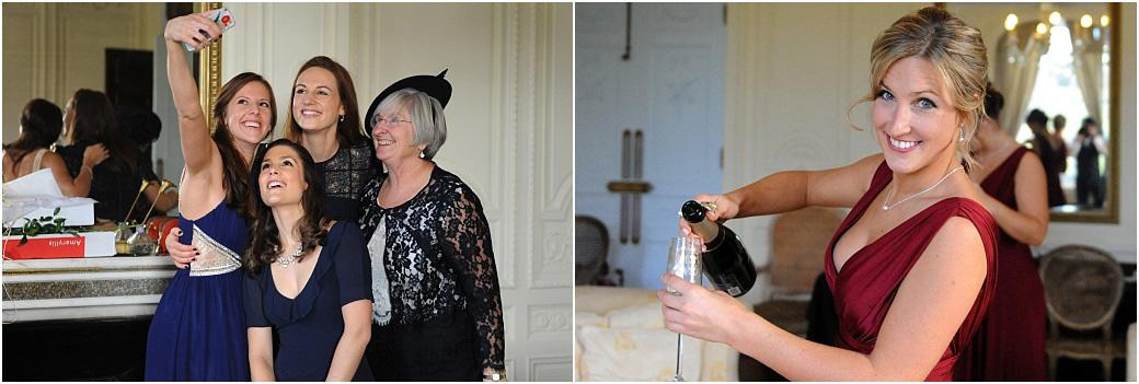Fun wedding pictures of smiling ladies selfies and more champagne as the fun begins in the Bridal Suite at Addington Palace a grand Surrey wedding venue in Croydon