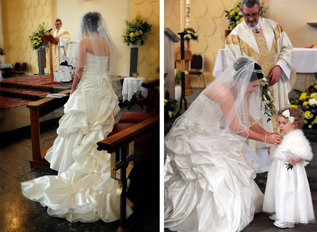 The Bride during the service in these beautiful dress wedding pictures taken by Surrey Lane wedding photographers at Addiscombe Catholic Church Our Lady of the Annunciation