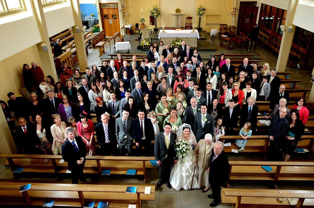 An everyone at the service wedding picture taken from the organ gallery at Addiscombe Catholic Church a Surrey wedding venue near Croydon