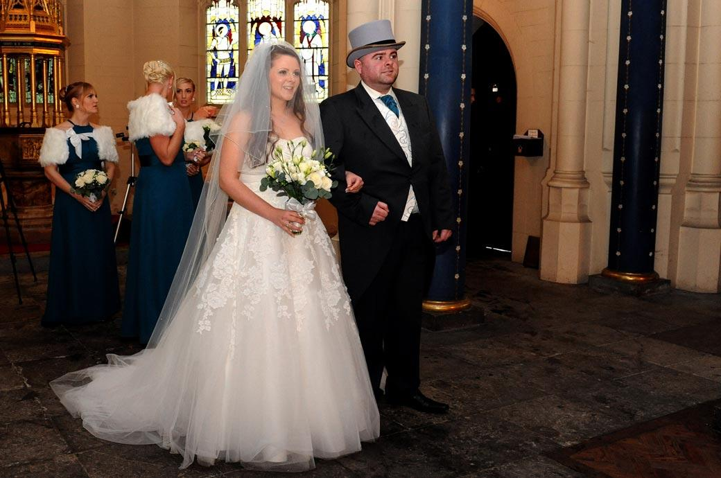 A beautiful bride ready to walk down the aisle wedding photograph taken at the historic All Saints Church in Carshalton Surrey
