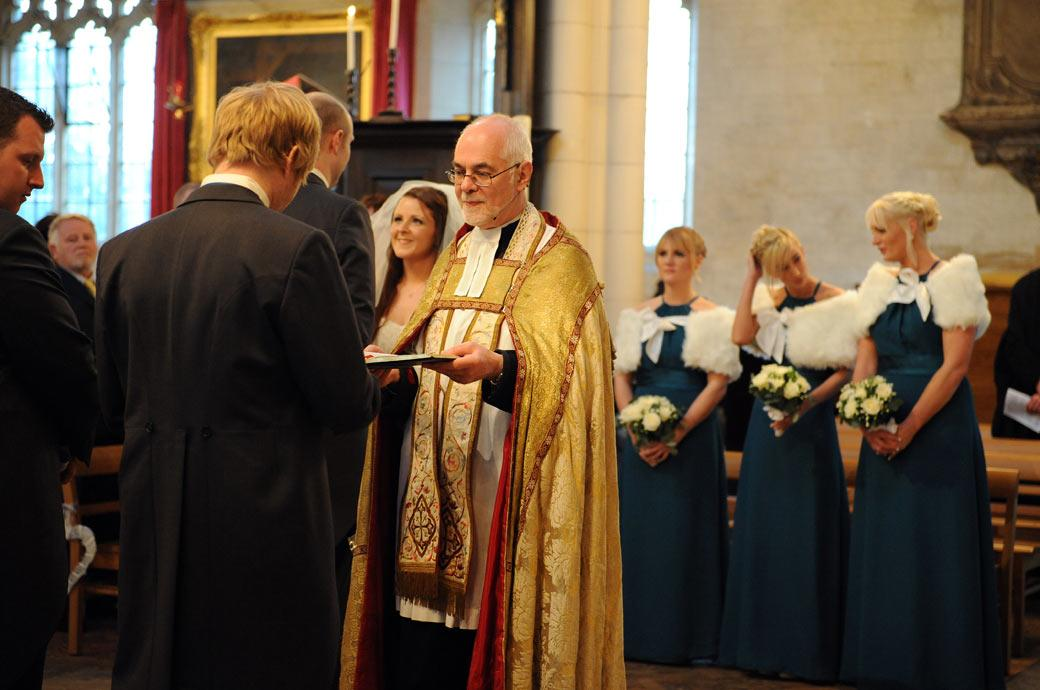 A golden wedding picture of the rector in all his finery awaiting the best man to present the wedding rings taken at All Saints Carshalton church
