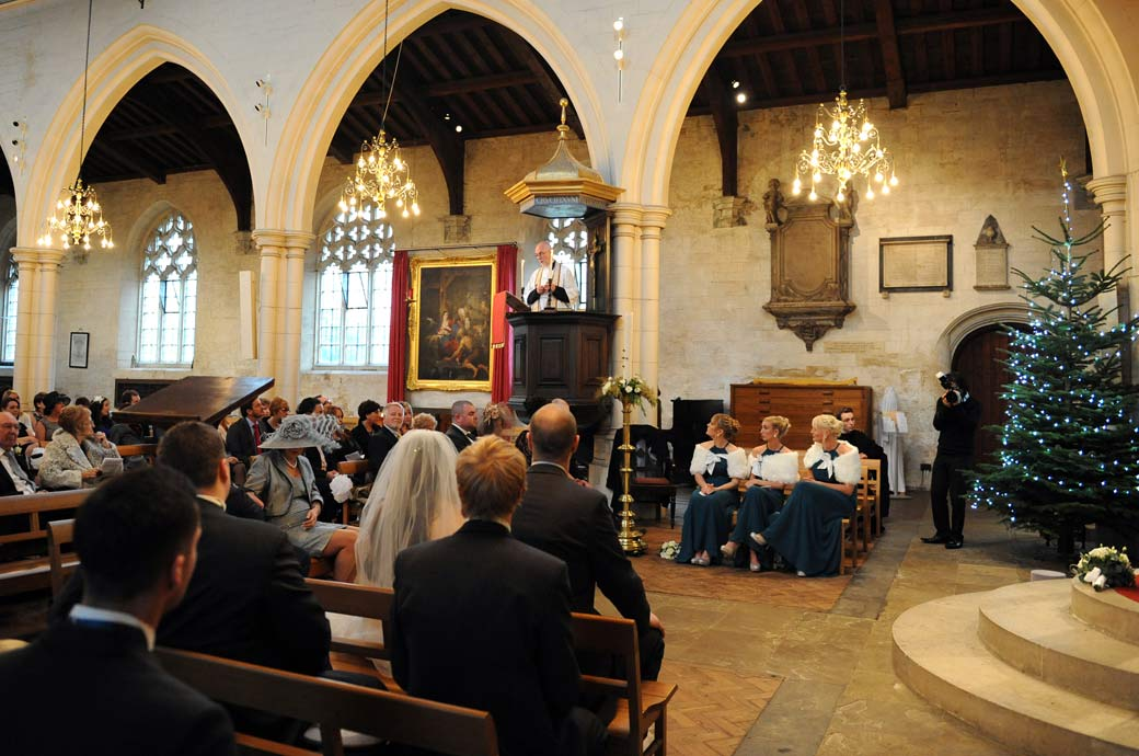 A Rector reading to his congregation from the pulpit wedding photo captured at the historic Surrey wedding venue at All Saints Church in Carshalton