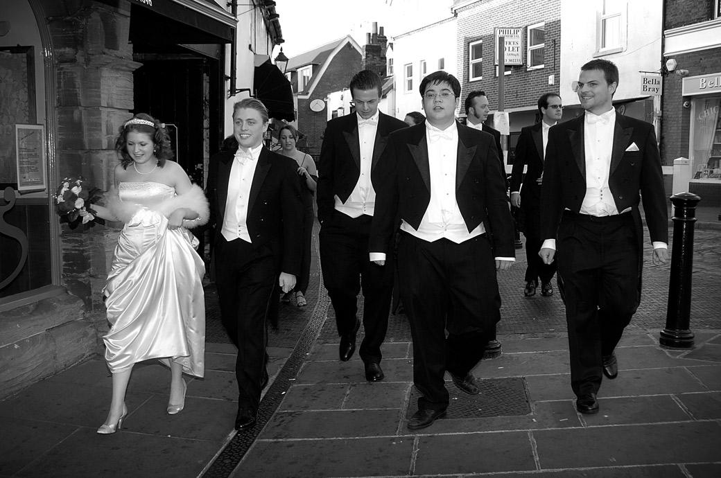 Bride and Groom lead the way down Guildford High Street in this wedding picture taken on route to Guildford Castle after an Angel Posting House ceremony