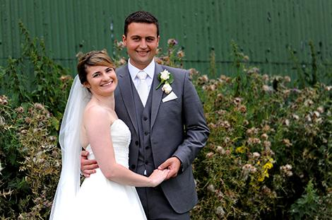 Very happy and relaxed looking young newlyweds having a break during a walk in the fields around the lovely rural and charming Surrey wedding venue Brewerstreet Farmhouse