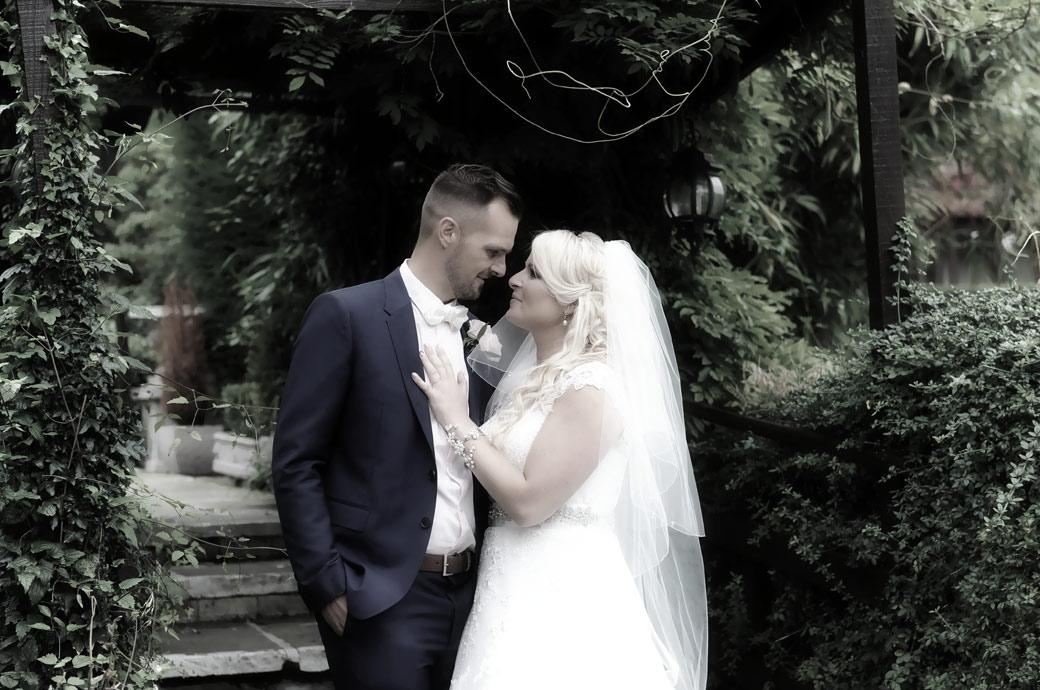 Intimate moment for the bride and groom in this romantic Burford Bridge Hotel wedding photograph captured by Surrey Lane wedding photographers