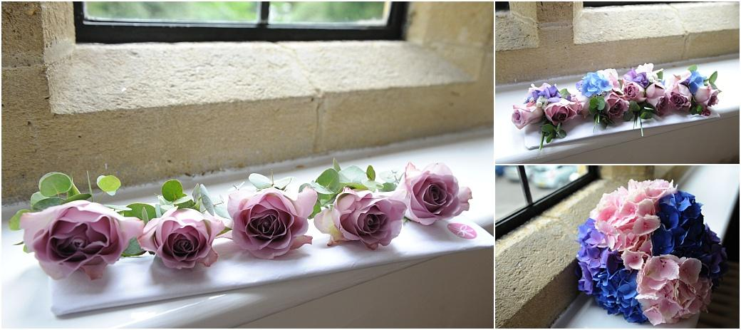 Wedding pictures of beautiful delicate button holes and a wedding bouquet in various pinks, blues and mauves captured at wedding venue Burrows Lea Country House in Surrey