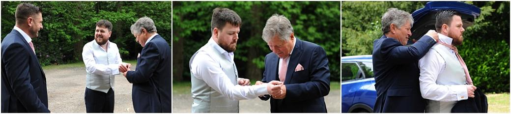Wedding pictures of the Groom being helped with his cufflinks and cravat as he prepares for his marriage ceremony at Surrey wedding venue Burrows Lea Country House near Shere Village