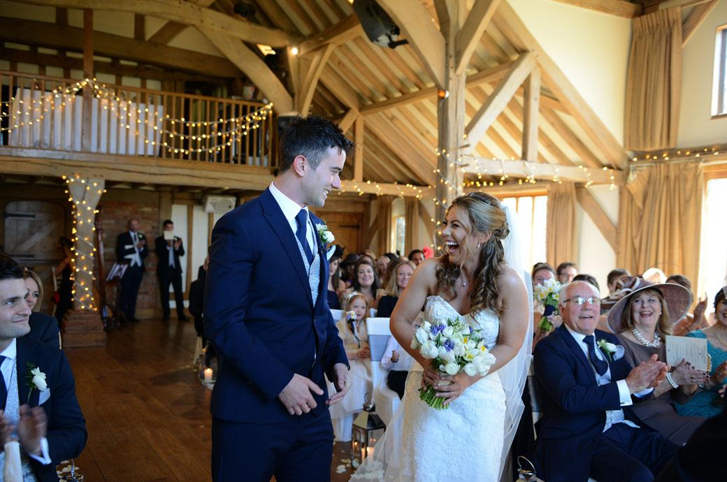 A time for fun and laughter as the bride and groom are announced as husband and wife in this hilarious wedding photograph from Cain Manor in Churt Surrey