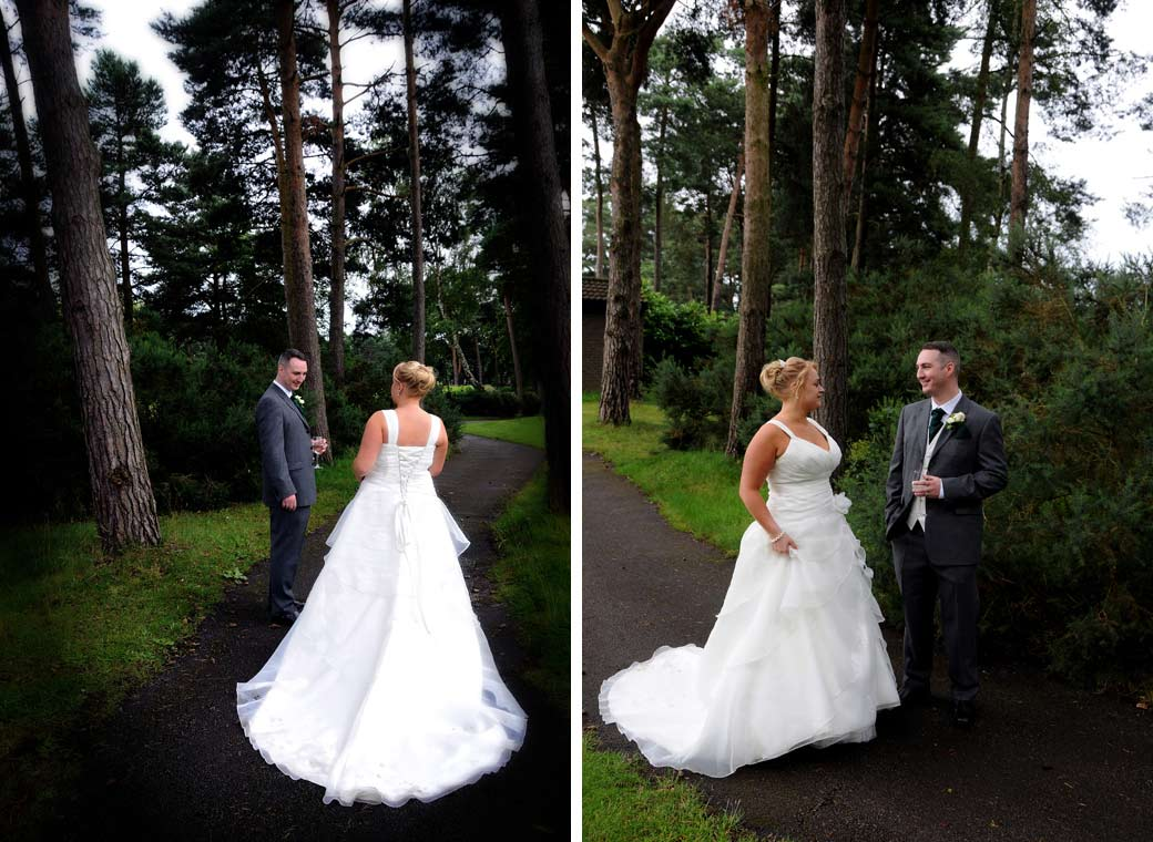 Two romantic wedding photos of the groom walking and talking with his fabulous looking wife in white on a woodland path at Camberley Heath Golf Club