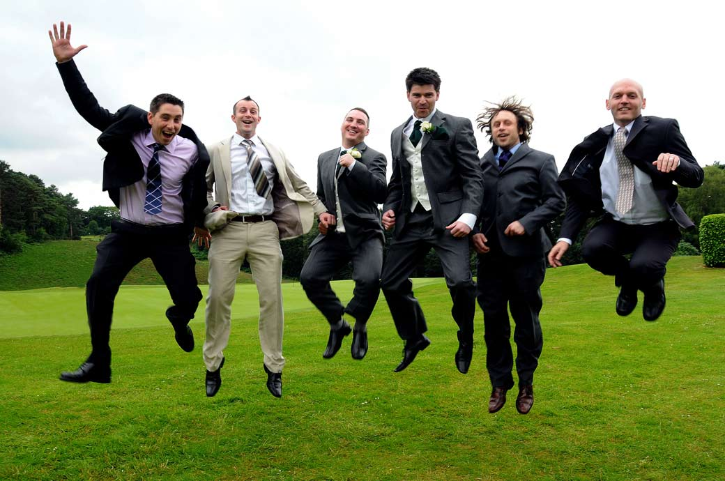 Fabulous and hilarious Groom and his men jumping up for joy wedding photograph taken at Camberley Heath Golf Club by Surrey Lane wedding photography