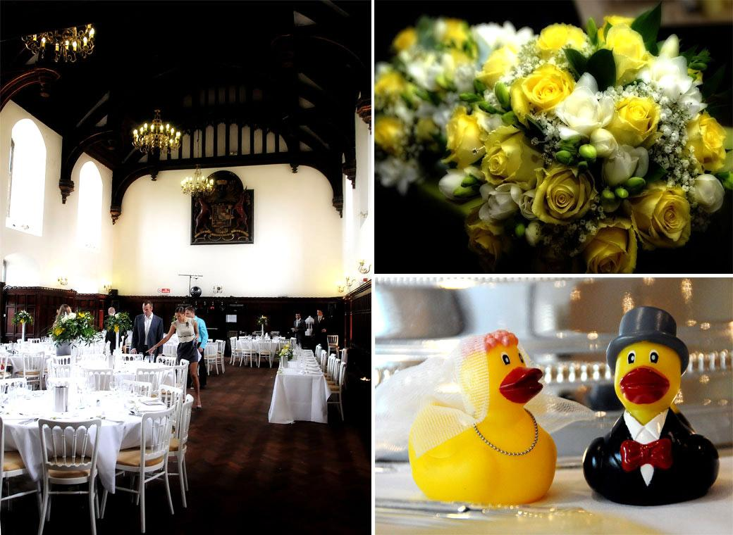 Cake toppers, flowers and table layout in the wonderful Hammerbeam roofed Tudor Great Hall at Surrey wedding venue Carew Manor in Beddington