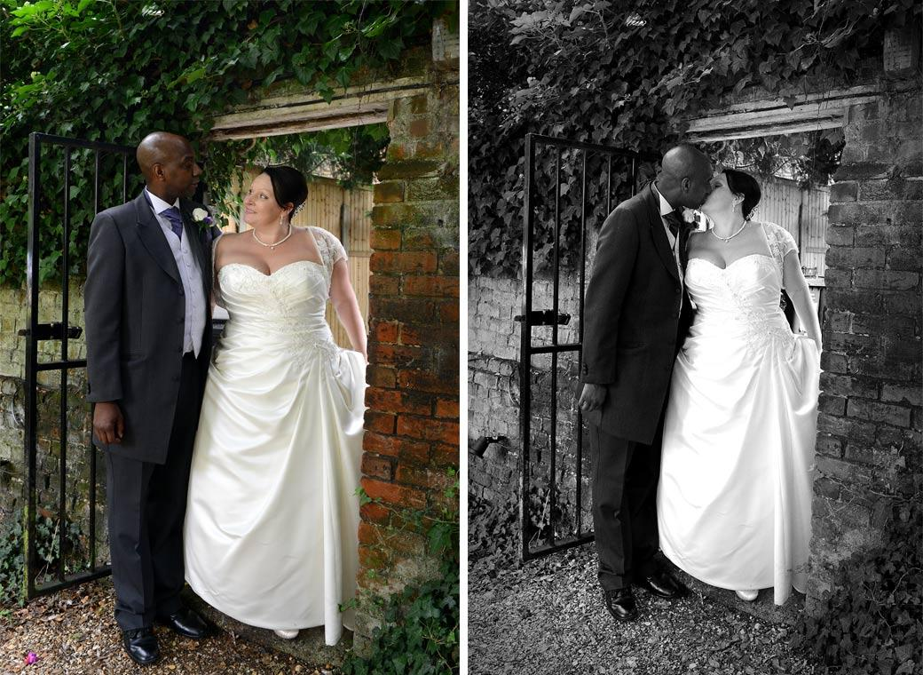 A look and kiss moment captured in these two wedding photographs as the newly-weds enter the garden through an arch gate at Chalk Lane Hotel a cosy and discrete Surrey wedding venue