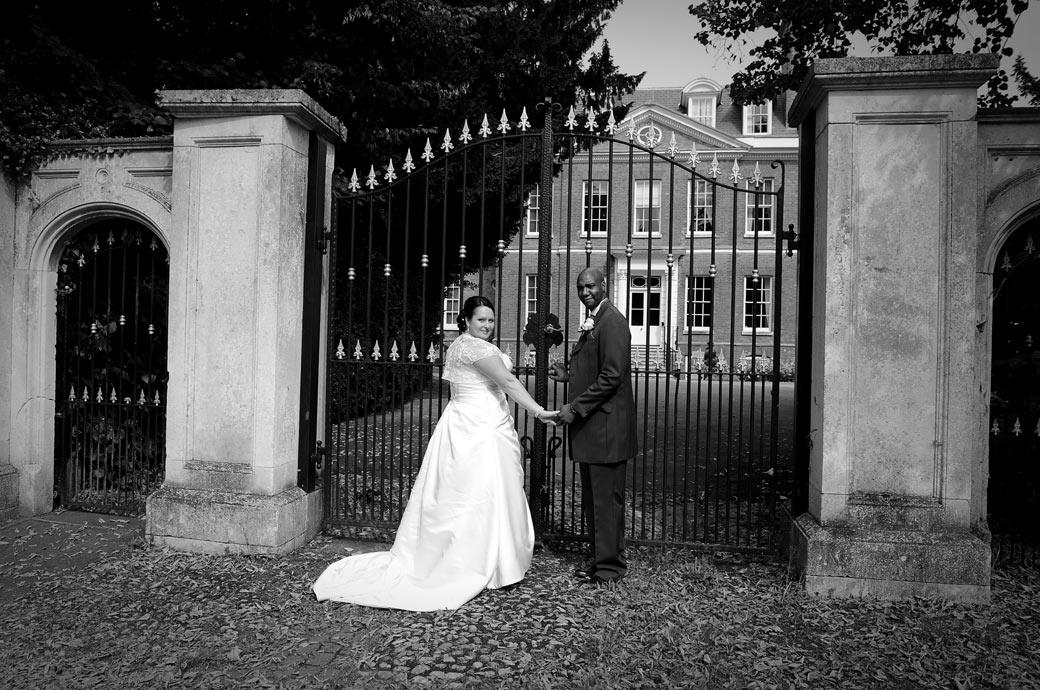 Wedding picture of the Bride and Groom standing in front one of the grand historic properties that can be found alongside Chalk Lane Hotel a charming Surrey wedding venue in Epsom