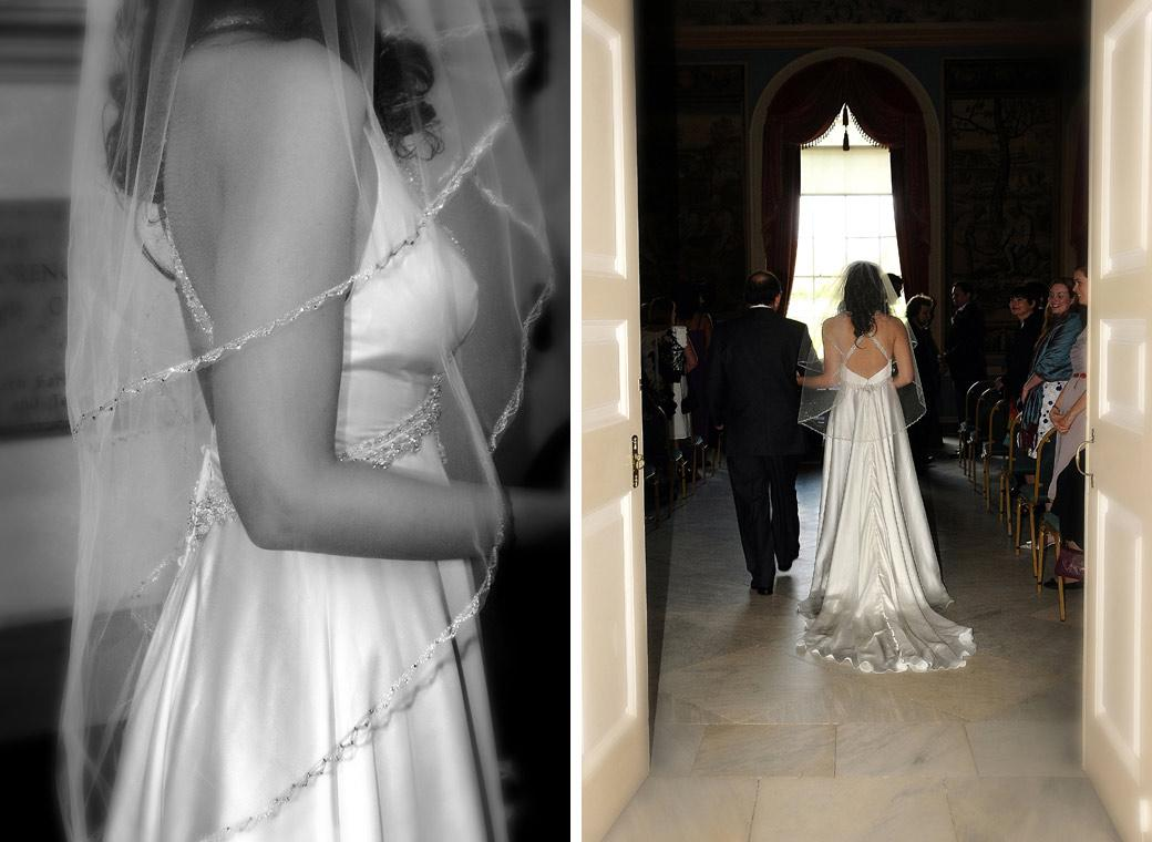 Bride's beautiful wedding dress photo taken as she walks down the aisle in the Tapestry Room taken at Clandon Park by Surrey Lane wedding photography