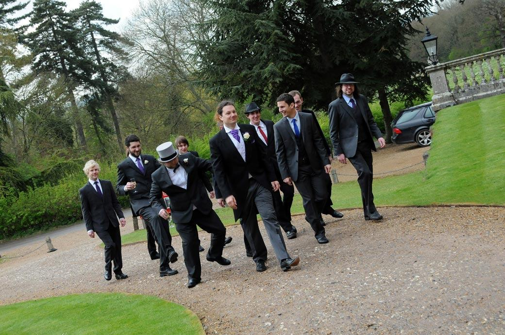 The boys get into their stride for the reception celebrations at the wonderful National Trust Surrey wedding venue Clandon Park in Guildford