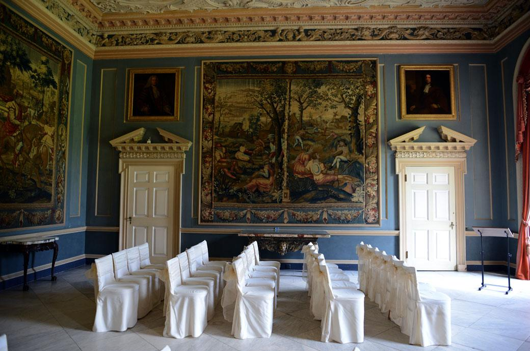 A wedding picture of an empty Tapestry Room awaiting the arrival of the guests at the glorious Palladian Surrey wedding venue Clandon Park Guildford