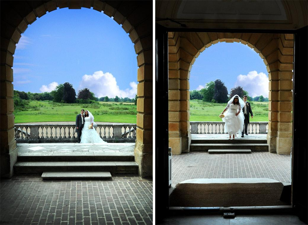 The Bride and Groom captured in these through the arch wedding pictures taken by Surrey Lane wedding photography at Clandon Park Guildford
