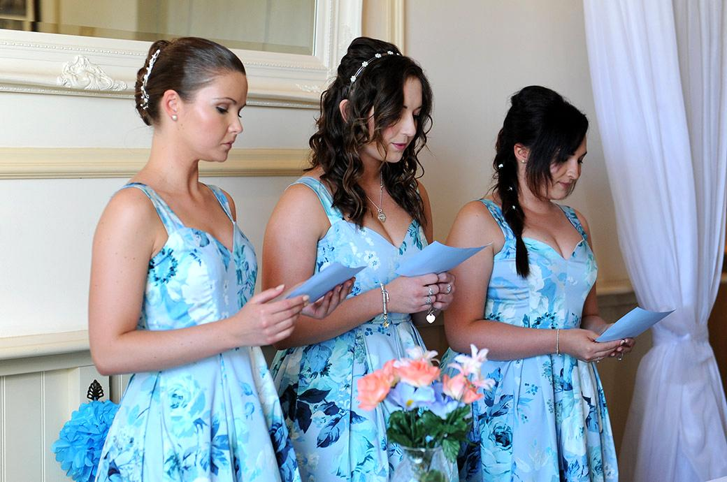 Three bridesmaids read out their special personal speeches to the Bride and Groom during a Clock Barn Hall marriage ceremony in Godalming Surrey