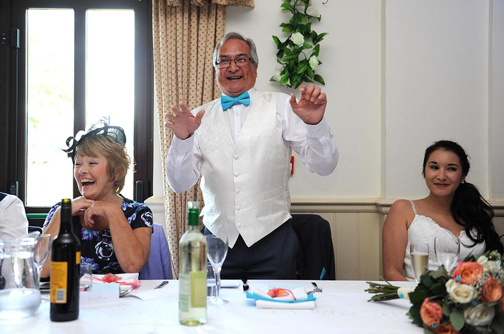 Wedding photograph of the father of the bride captured at the delightful Surrey wedding venue Clock Barn Hall in his prime during his entertaining wedding speech