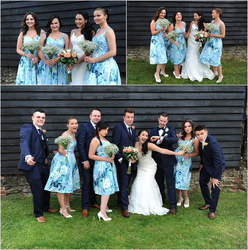 A combination of relaxed and fun wedding party group photographs taken in the shade on a hot summers day at the popular rural wedding venue Clock Barn Hall in Surrey