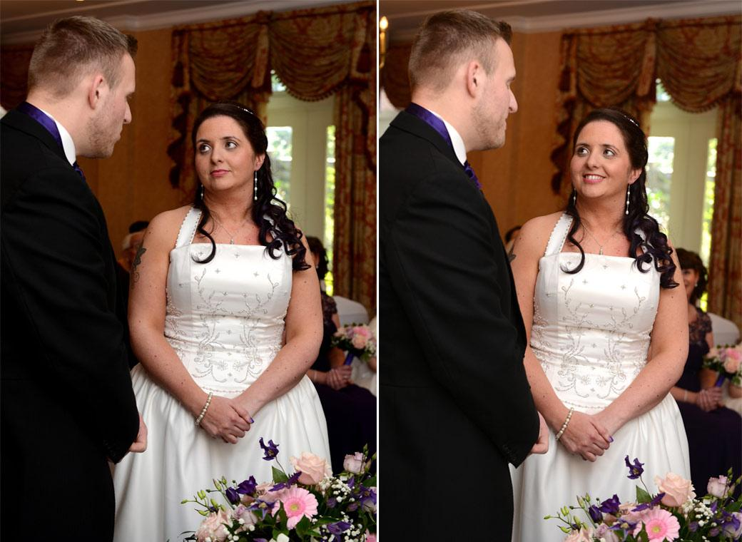 The Bride listens to the Groom saying his marriage vows and smiles in these sweet wedding photos taken at Coulsdon Manor Surrey in The Manor House Suite