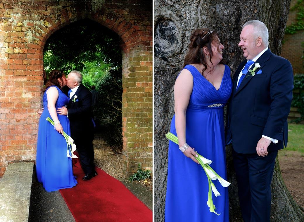Laughter by a tree and romance under the arch captured in these two wedding pictures taken in the grounds of Coulsdon Manor by Surrey Lane wedding photographers