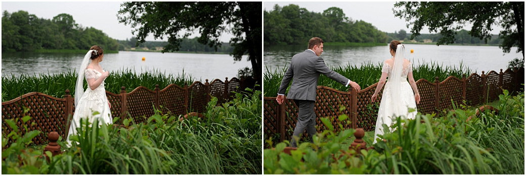 Romantic wedding picture taken from Surrey wedding venue Frensham Ponds Hotel through the reeds of a Bride being joined by her husband for a walk along the boardwalk
