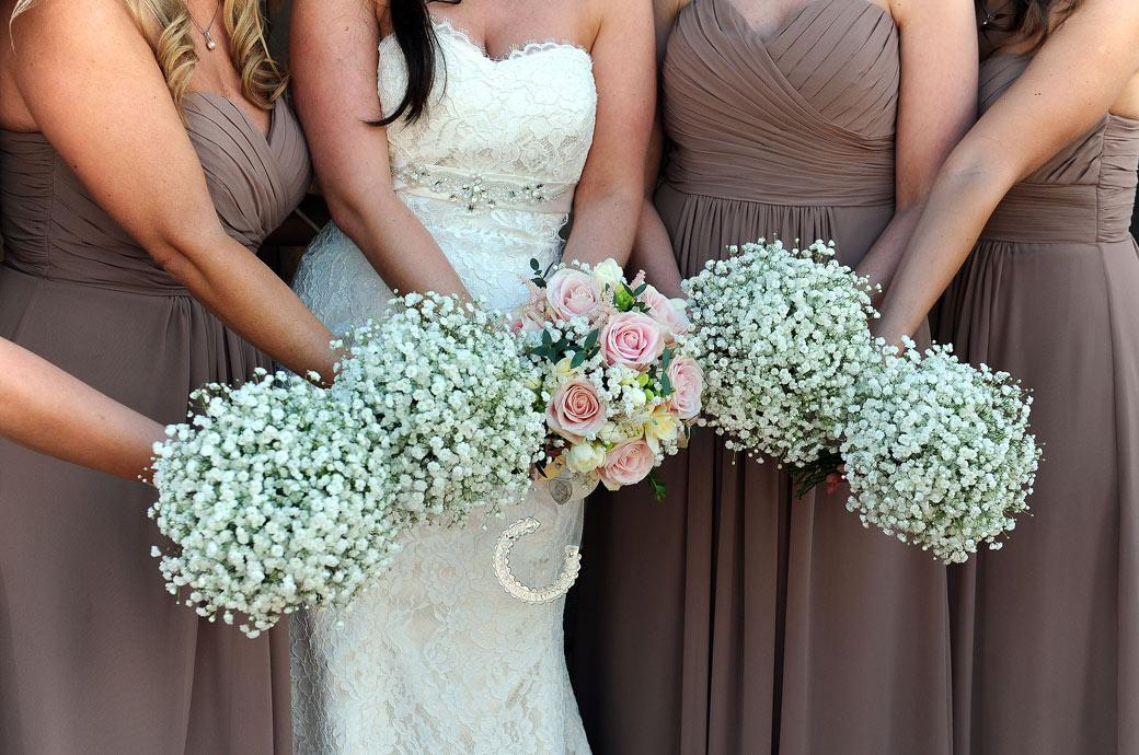 Close up wedding picture of the Bride and Bridesmaids beautiful bouquets taken at Gate Street Barn a very popular and beautiful Surrey wedding venue near Guildford in Bramley