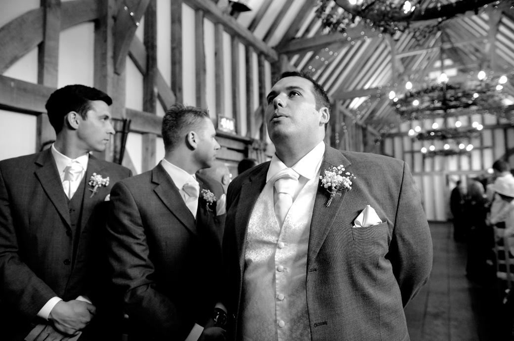 A highly charged Groom takes a breath as he waits for the arrival of the Bride in this emotional wedding picture captured at a Gate Street Barn wedding in Surrey