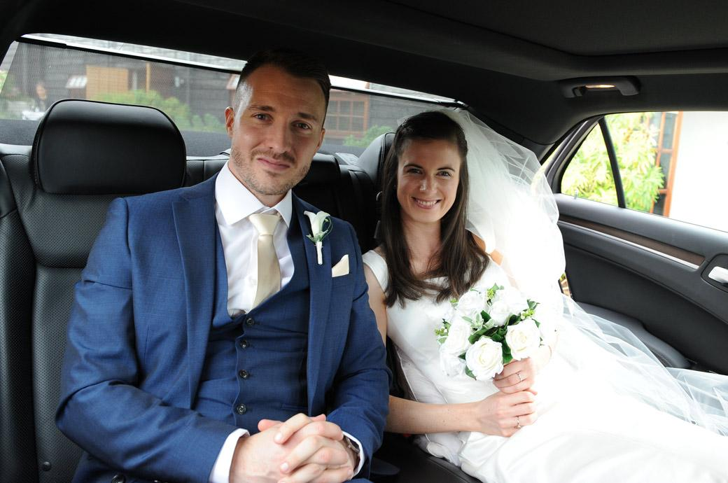 Excited Bride and groom captured in this sweet photo in Bramley Surrey at the lovely rustic Gate Street Barn on their arrival in their wedding car