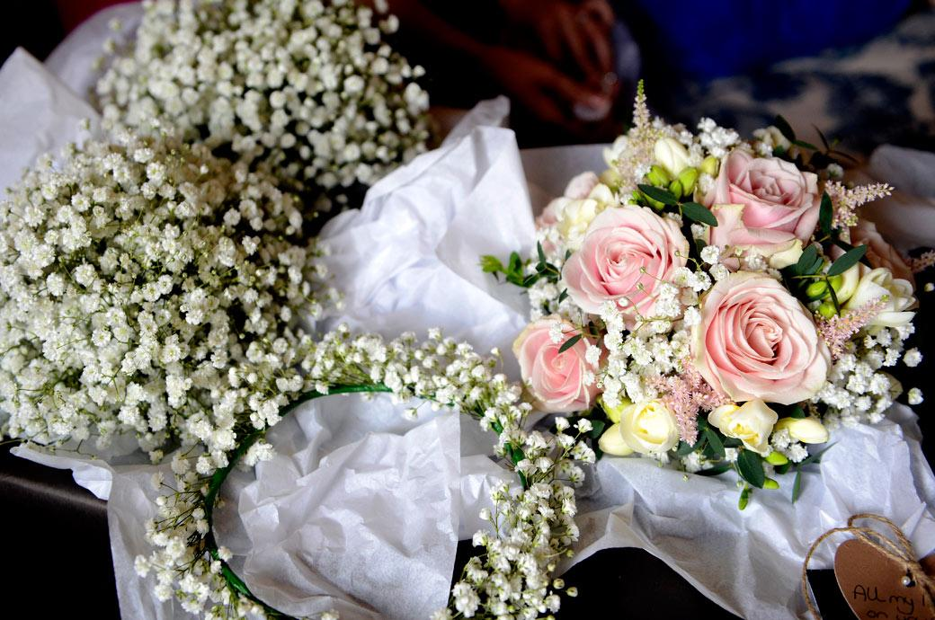 Lovely delicate Bride and Bridesmaids' bouquets captured in this wedding photo by Surrey Lane wedding photographers at the charming Gate Street Barn waiting to be picked up
