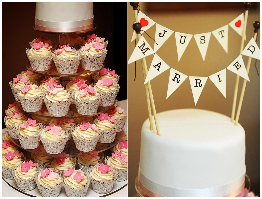 White wedding cake comprised of three tiers of pink and yellow cup cakes captured in the Lakeview Room at the Surrey venue Gatton Manor in Dorking