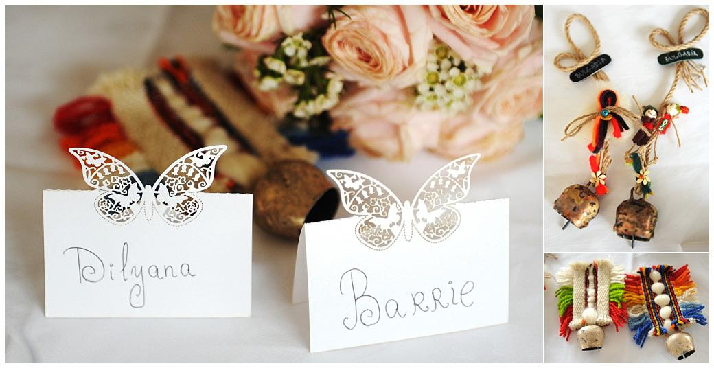 Bride and groom butterfly place names and brightly coloured Bulgarian bell favours captured at Surrey wedding venue Gatton Manor in The Lakeview Room