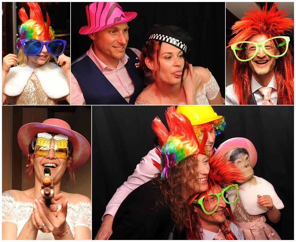 Fun and games at Surrey wedding venue Gatton Manor in Dorking as everyone dresses up in the colourful photo-booth hats and costumes