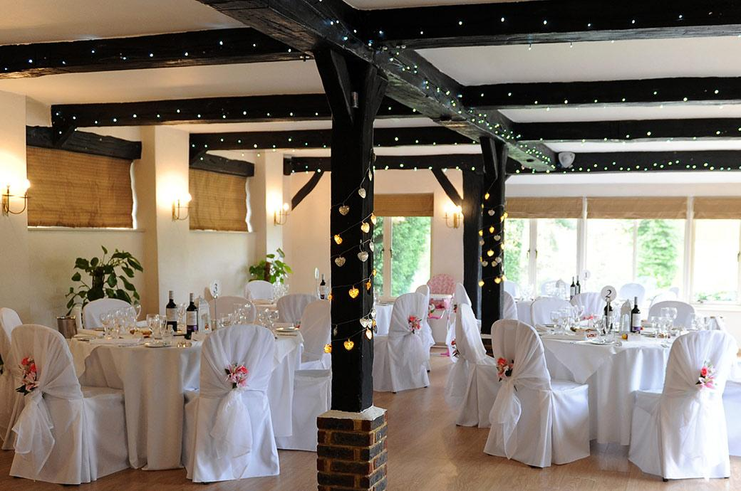 Wedding breakfast set up in the Lakeview Room at the popular Surrey wedding venue Gatton Manor in Dorking Surrey