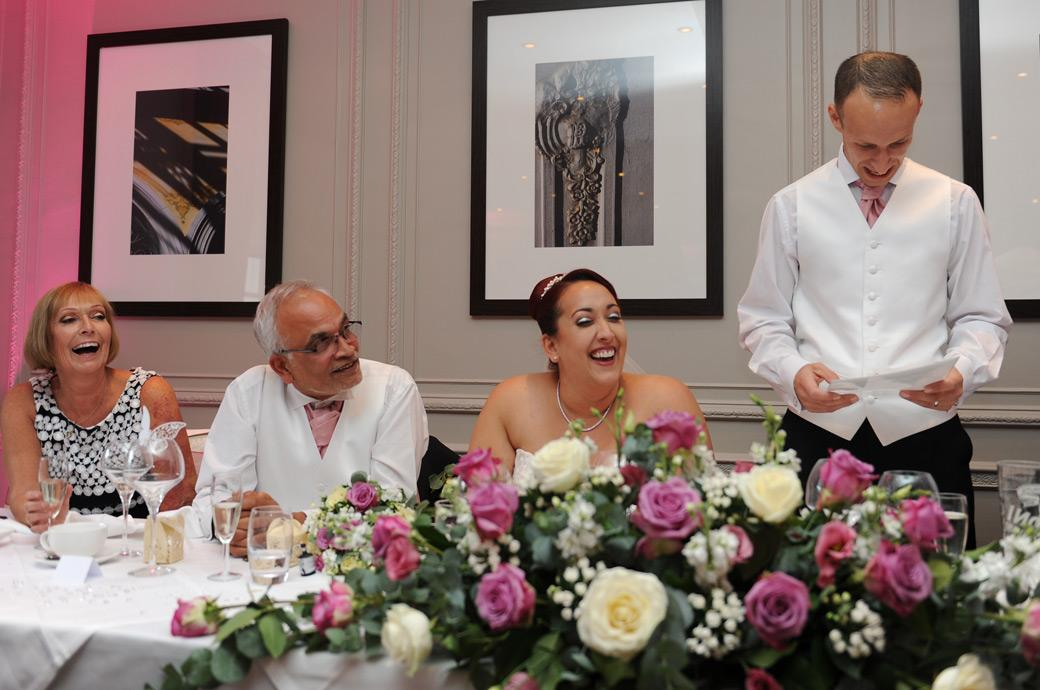 Groom at Gorse Hill in Woking captured by a Surrey Lane wedding photographer in The Restaurant has everyone in stitches during the wedding speeches
