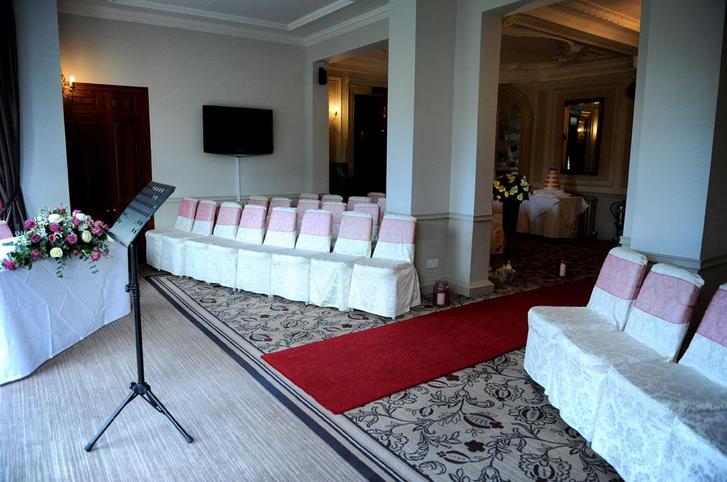 Wedding photograph of the intimate and welcoming lounge dressed for the marriage ceremony at Gorse Hill Woking a fine wedding venue in Woking Surrey