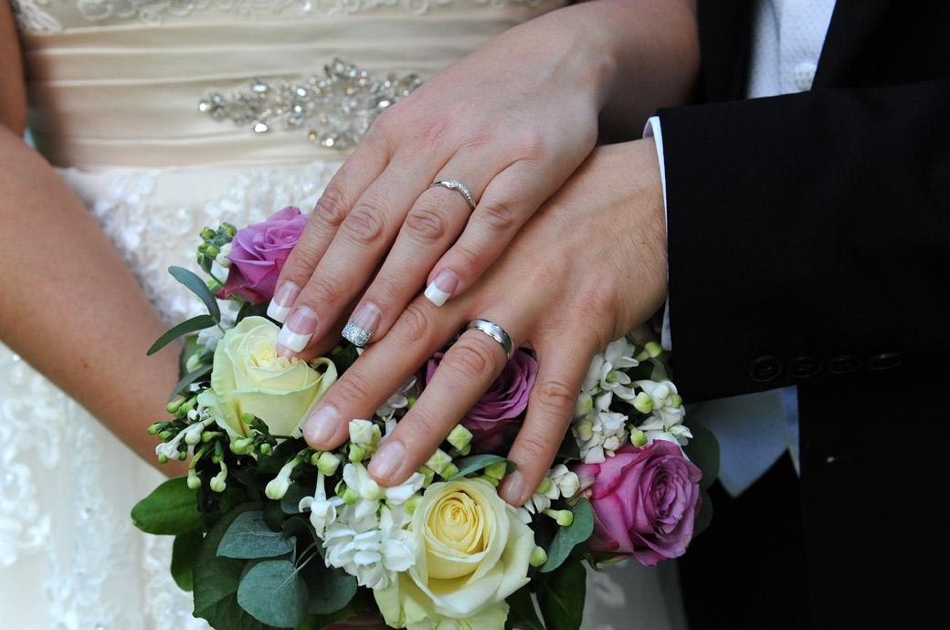 Sparkling wedding rings on show in the lovely grounds of Gorse Hill in Woking captured by the Surrey Lane wedding photographers on a sunny wedding afternoon