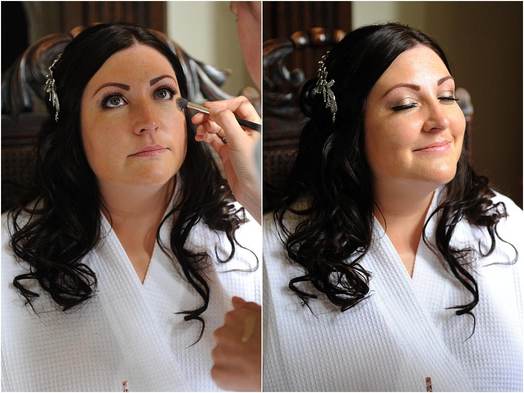 A serene beautiful smiling Bride having her make up applied as she relaxes in her bathrobe during her preparations for her Great Fosters wedding in Egham Surrey