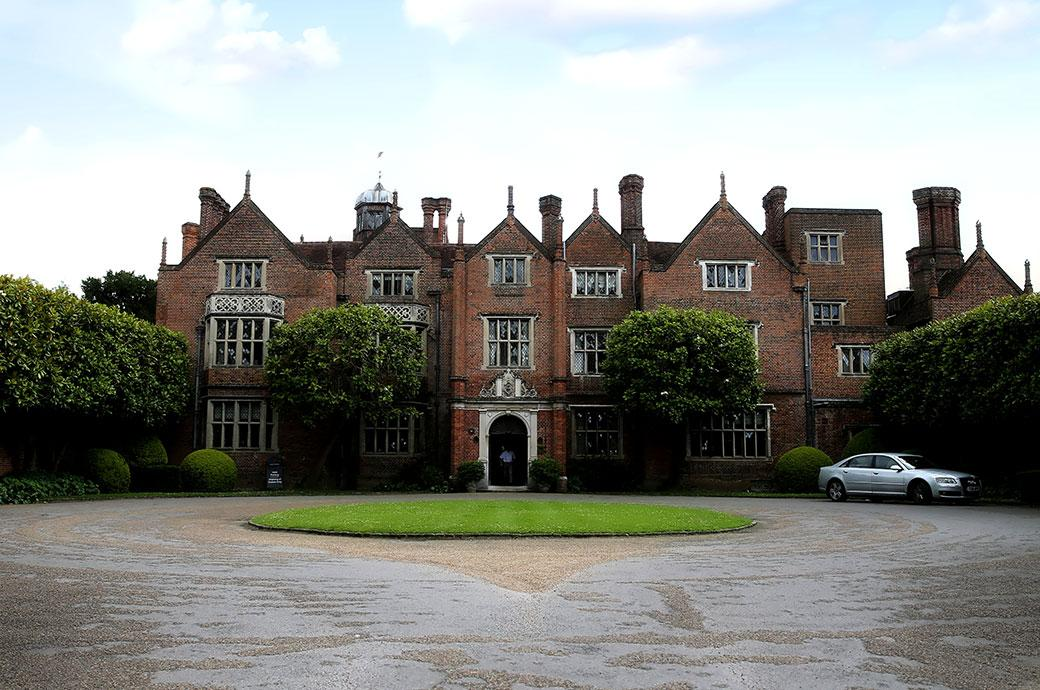 The front of the wonderfully grand and interesting Grade One listed Great Fosters Hotel a truly first rate Surrey wedding venue situated in the tranquil countryside of Egham