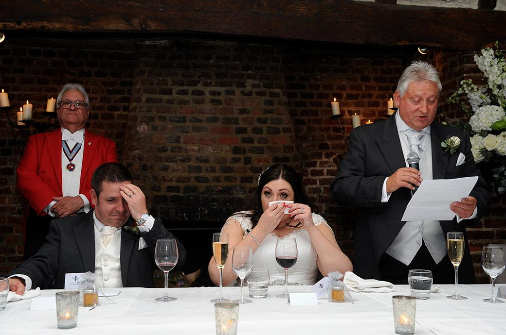 Father of the Bride's wedding speech brings out the tissues as well as the smirks from the top table at Great Fosters Egham in Surrey during the Tithe Barn reception