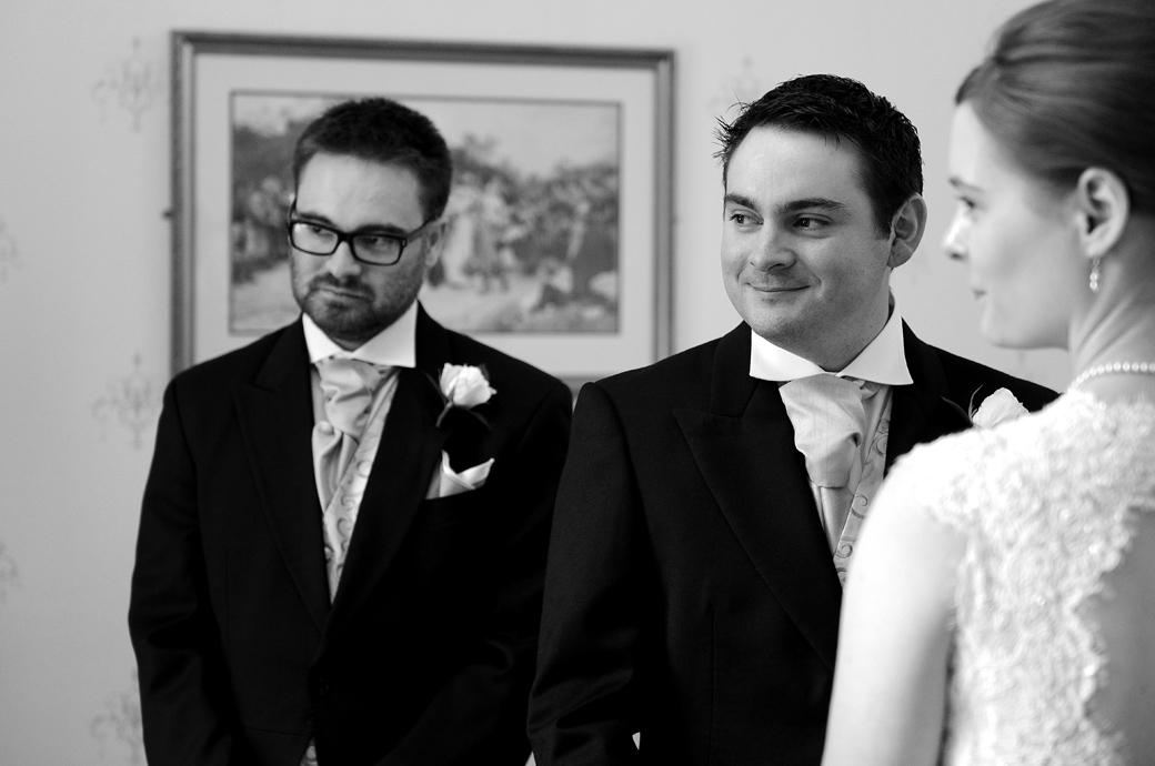 The Bride and Groom look over to the Registrar as they state their names in this wedding picture taken at Surrey wedding venue Guildford Register Office in the Guildown Room