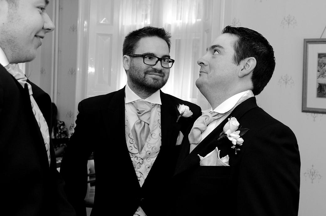This funny wedding picture shows the Groom pulling a face as he waits with his Groomsman in the Guildown Room at Guildford Register Office a popular Surrey wedding venue