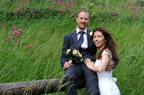 Newlyweds enjoy some romantic moments in Guildford Castle Gardens after their marriage at Surrey wedding venue Guildford Register Office in Artington House